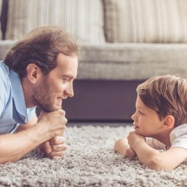 boy and dad playing
